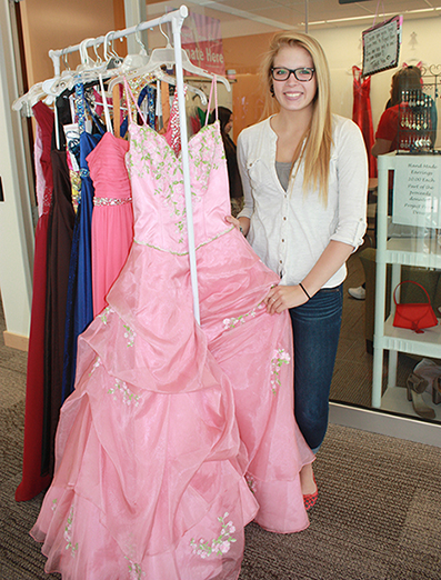 Christine Dodd holding up a prom dress