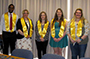 five students wearing yellow ribbons