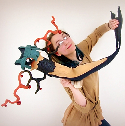 Nicole Barber, a digital media and animation major from Rochester, dances with one of the marionettes