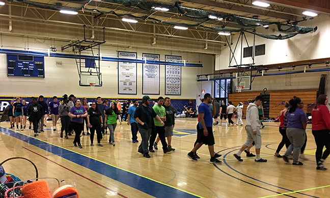 several people walking in the gymnasium