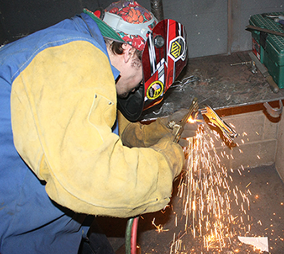 high school student competes in the welding contest during the 27th annual SkillsUSA Region I Leadership Conference and Skills Olympics