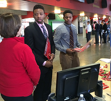 students Samuel Volmy, of Lockport, left, and Justin Wallace, of Mount Vernon, speak with a representative from iHeart Radio