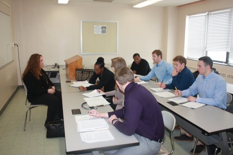 Alfred State students meet with a Hornell business owner.