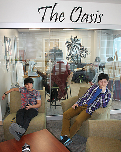 students sitting in chairs in front of The Oasis