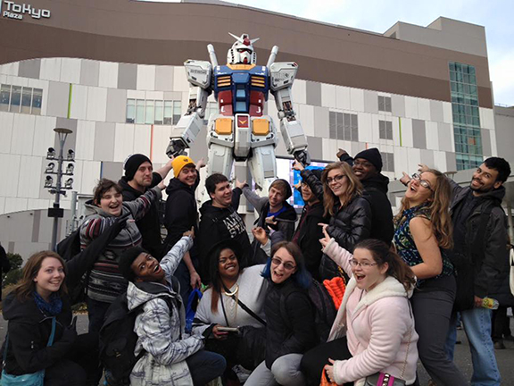 students pictured by the Gundam Statue in Odaiba, Japan