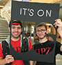 "Tyler Ribble, business administration, Elmira, left, and Adam Johnson, architecture, Williamson, pose with an ""It's On Us"" cut-out sign"