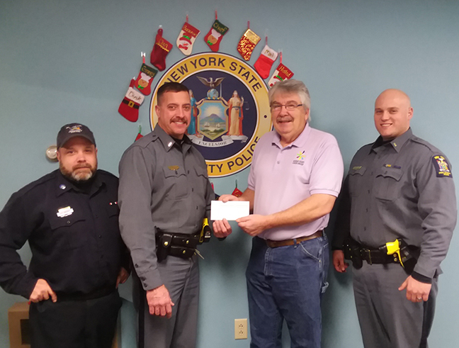 Lt. Scott Bingham presents Rod Ballengee a check, Craig Heller and Kris Bianchi