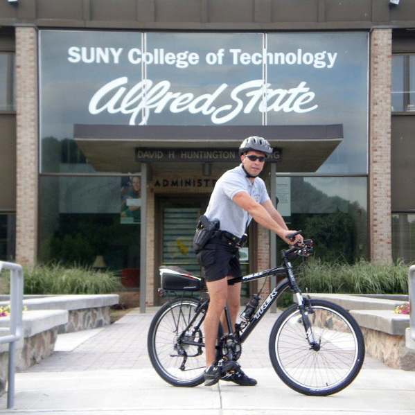 Officer on bike at Alfred State College