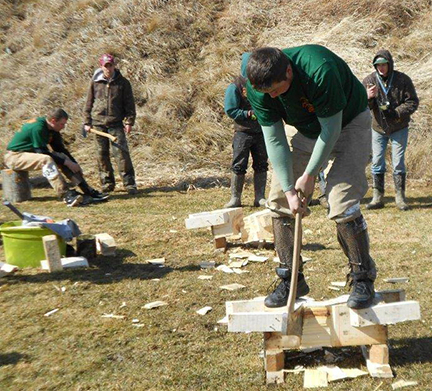 Pioneer Woodsmen's Club member Gavin Maloney, a masonry major from Rome, NY, performs an underhand chop