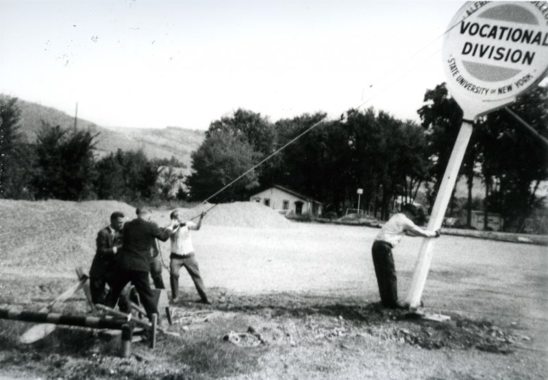 In 1966, Alfred State students and staff erect a sign in Wellsville as the first classes were held on the former Sinclair Refinery site.
