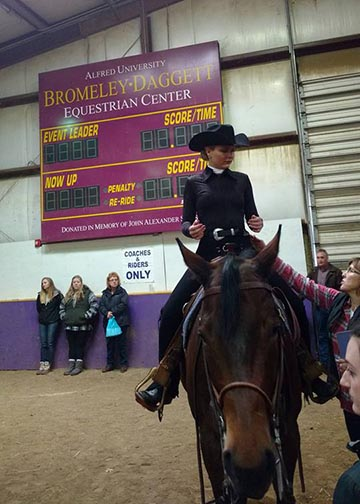 Kristin Reynolds rides in Western competition