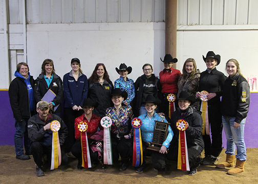 Western team gathered together with seven members showing off their ribbons