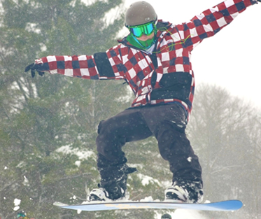 student on a snowboard