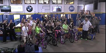 Elk Charity Challenge participants sitting on bikes that they assembled