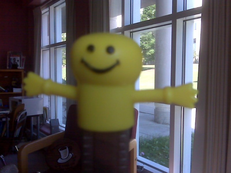 yellow stick figure with smile and arms spread open