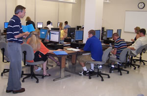 students seated at computers in a lab at summer orientation