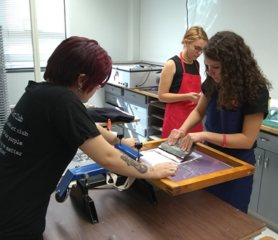 students printing a t-shirt design