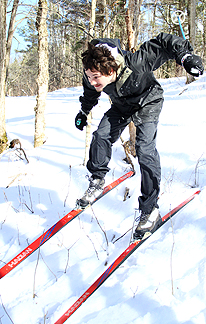 student downhill skiing