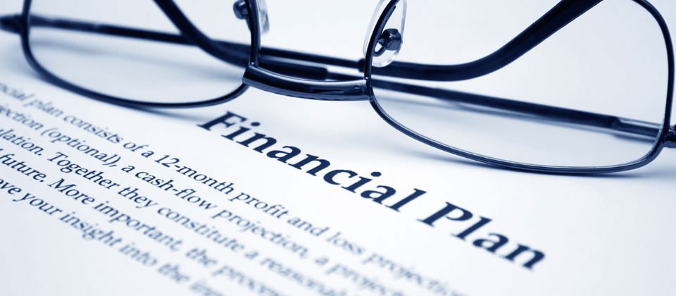 glasses on top of a paper that says financial plan