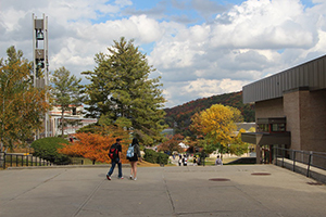 two students walking in front of the library on campus