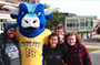 Big Blue ox standing on campus with four students