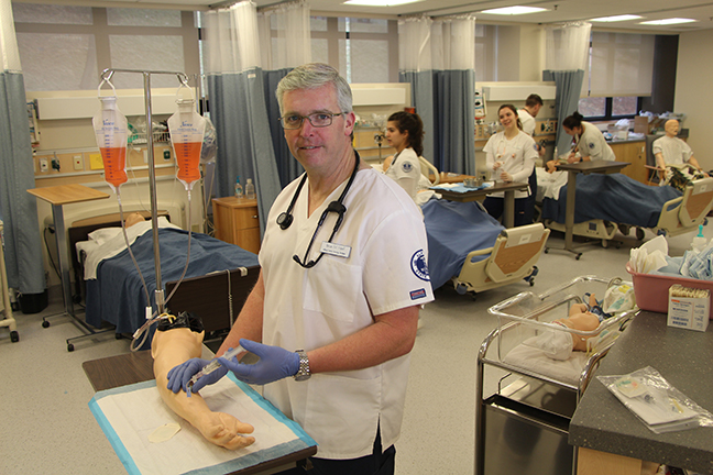 Pictured is nursing student and Air Force veteran Brian Hierl, of Nunda in a nursing lab on campus