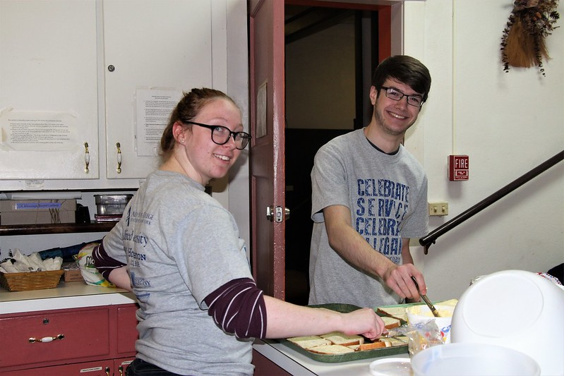 two students working in a kitchen