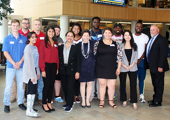SUNY Board of Trustees Chair Dr. Merryl H. Tisch, front row, fourth from left, and SUNY Senior Vice Chancellor Johanna Duncan-Poitier, front row, third from left, pose for a photo with Alfred State students and President Dr. Skip Sullivan during a recent visit to the college.