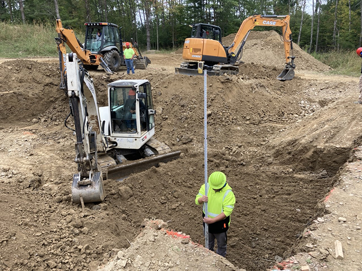 heavy equipment operations student is shown here digging the foundation of the house.