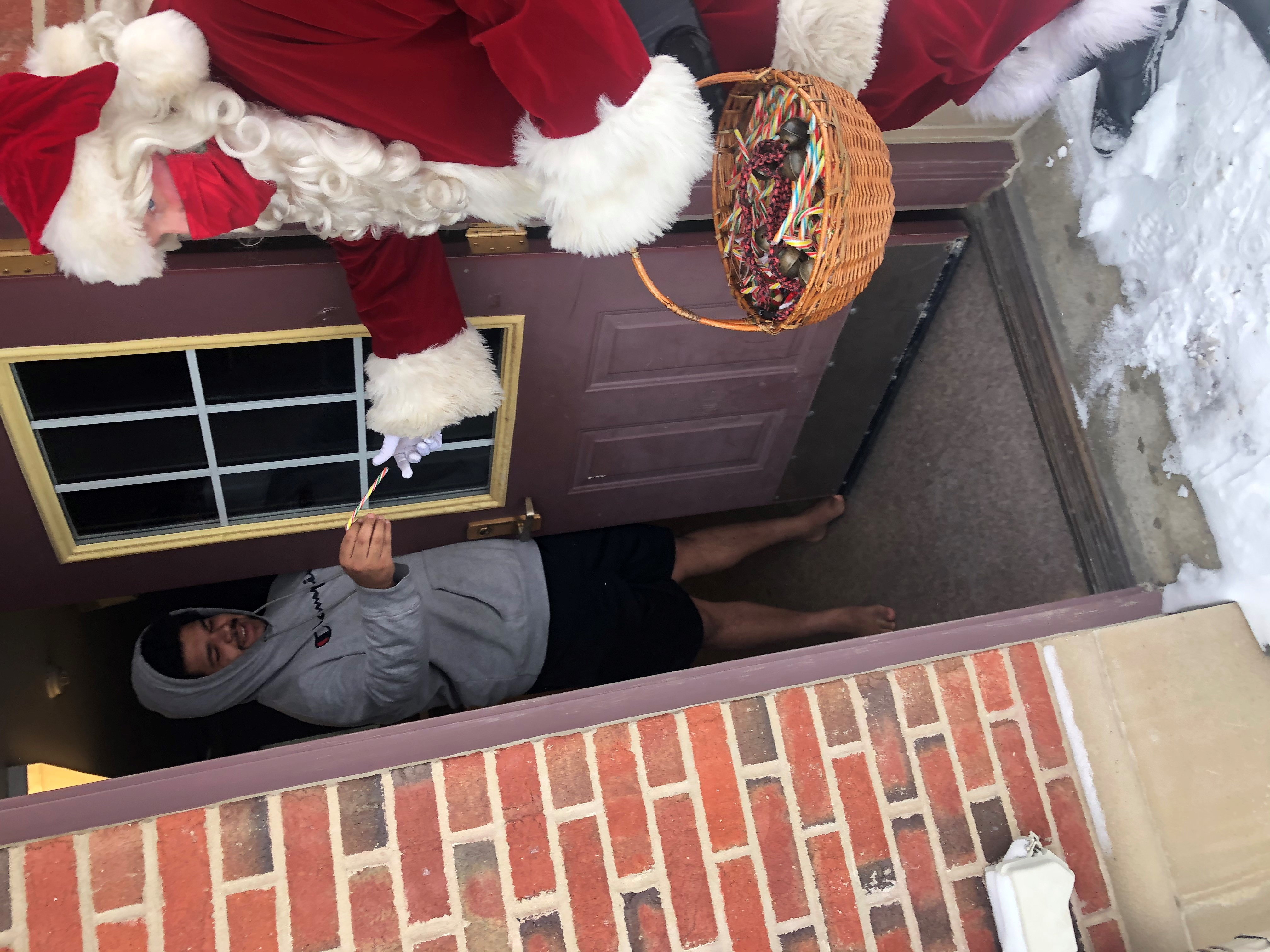 Santa Claus delivers gifts to students