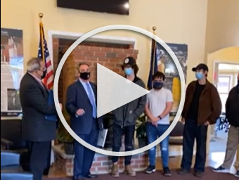 Senator and Assemblyman with students, play button to YouTube video