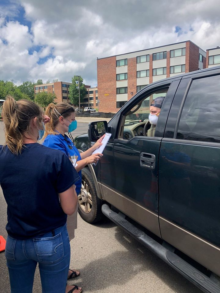 Alfred State employees administer a screening process as students begin returning to campus.