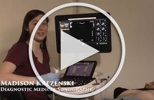 student in a lab with sonography equipment, link to youtube video