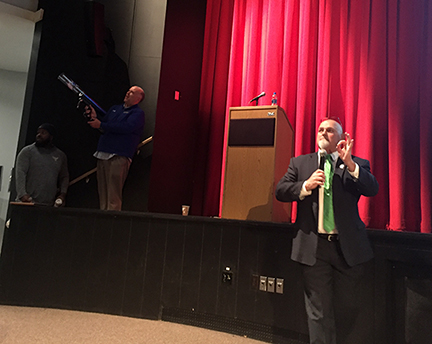 Assistant Director of Athletics/Media Relations Paul Welker fires a T-shirt into the crowd at President Dr. Skip Sullivan's spring 2020 Opening Remarks presentation.